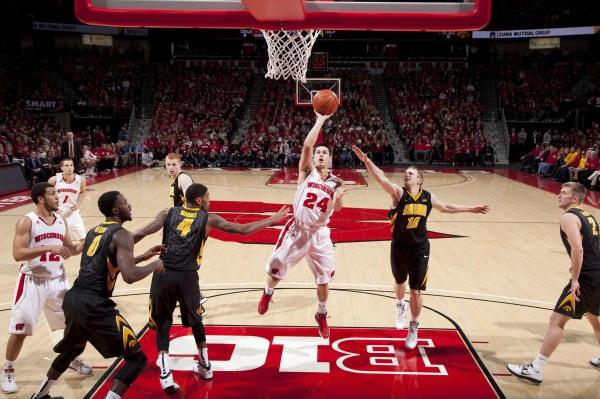 G Bronson Koenig (24) attempts a shot during the Badgers' game vs. Iowa, Jan. 5, 2014 (David Stluka photo)