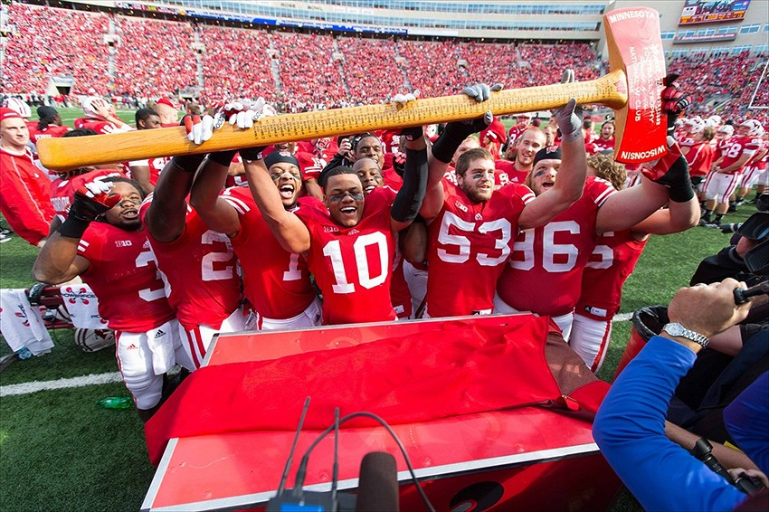 Oct 20, 2012; Madison, WI, USA; The Wisconsin Badgers celebrate with the Paul Bunyan Axe following the game against the Minnesota Golden Gophers at Camp Randall Stadium. Wisconsin defeated Minnesota 38-13. PHOTO: Jeff Hanisch-USA TODAY Sports