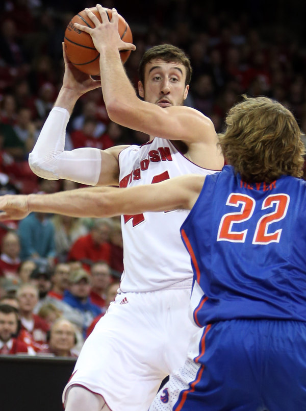 Wisconsin forward Frank Kaminsky (top) looks to pass as Boise State Broncos guard Robert Heyer (22) defends. PHOTO: Mary Langenfeld-USA TODAY
