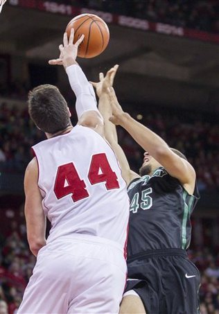 Badgers center Frank Kaminsky gets one of his seven blocks. – AP Photo by Andy Manis
