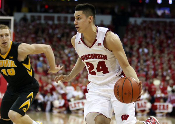 Wisconsin's Bronson Koenig (24) brings the ball down the floor as Iowa's Mike Gesell (10) defends at the Kohl Center. PHOTO: Mary Langenfeld, USA TODAY