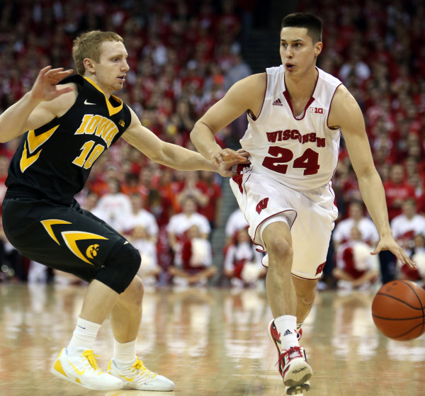 Wisconsin's Bronson Koenig (24) brings the ball down the floor as Iowa Hawkeyes guard Mike Gesell (10) defends. PHOTO: Mary Langenfeld, USA TODAY
