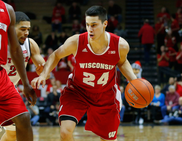 Wisconsin guard Bronson Koenig (24) brings the ball up court during the first half against the Rutgers . PHOTO: Jim O'Connor, USA TODAY
