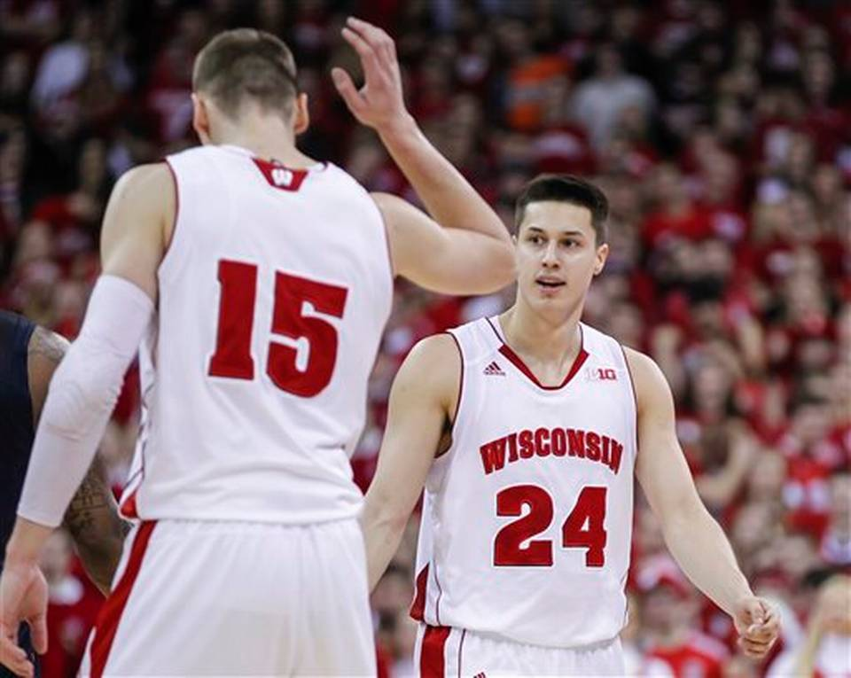 Wisconsin's Bronson Koenig (24) high-fives Sam Dekker after hitting a 3-pointer during against Illinois. | Andy Manis, AP