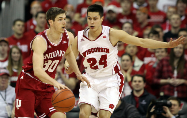 Indiana forward Collin Hartman (30) runs offense with Wisconsin's Bronson Koenig (24) defending, at the Kohl Center. PHOTO: Mary Langenfeld (USA TODAY)