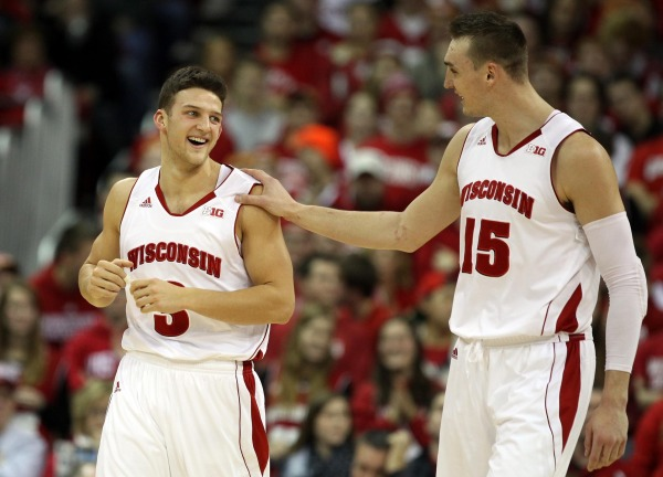 Wisconsin guard Zak Showalter (3) gets a pat on the shoulder from teammate Sam Dekker (15) at the Kohl Center. PHOTO: Mary Langenfeld (USA TODAY)