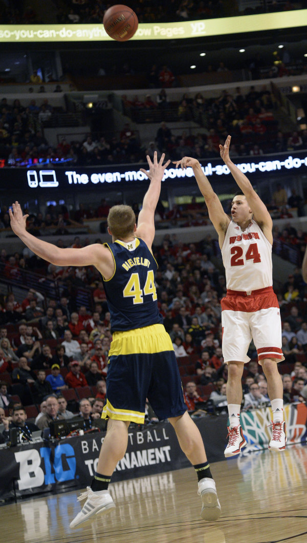 Wisconsin guard Bronson Koenig (24) shoots over Michigan forward Max Bielfeldt (44) in the first half in the quarterfinals of the Big Ten Tournament at the United Center. PHOTO: David Banks, USA TODAY
