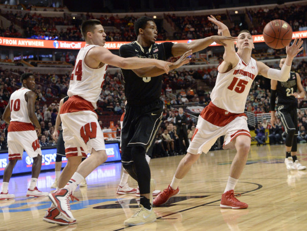 Purdue forward Basil Smotherman (middle) passes the ball away from Wisconsin guard Bronson Koenig (24) and forward Sam Dekker (15) during the first half in the semifinals of the Big Ten Tournament at United Center. PHOTO: David Banks / USA TODAY