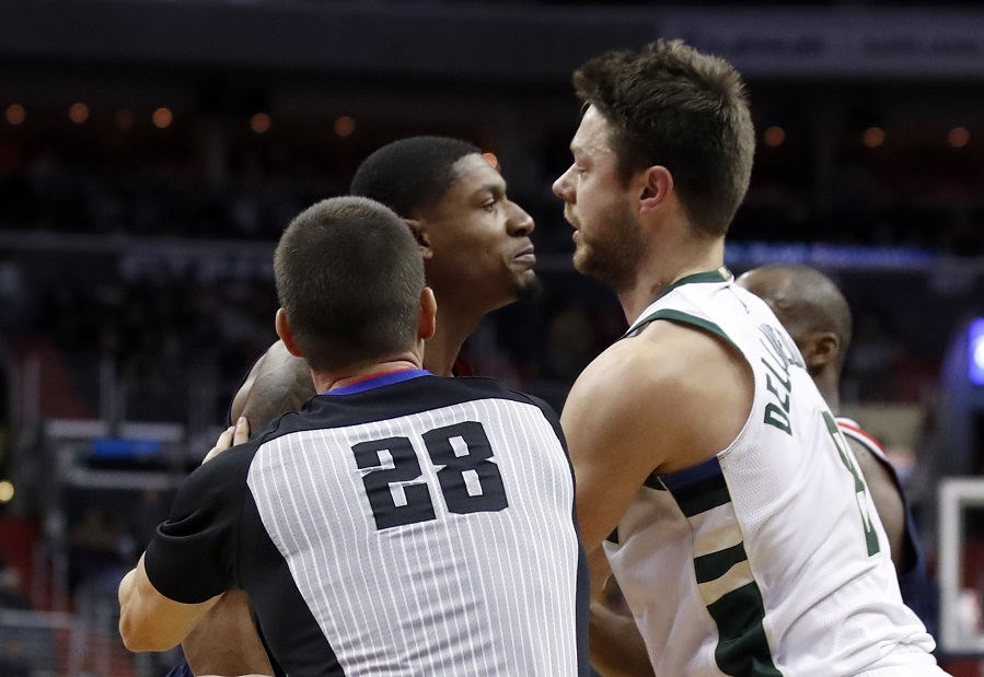 "WATCH: Dellavedova tries to take Beal's head off, says he was trying ""to hold him up."""