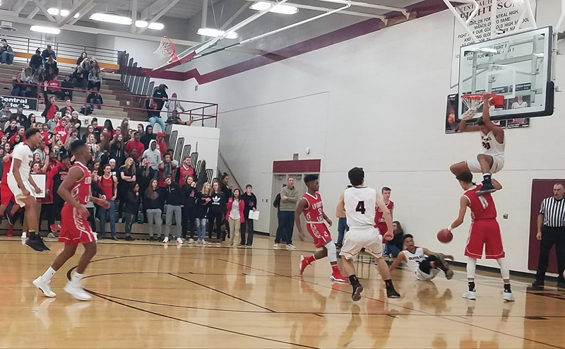 WATCH: Central's Johnny Davis with the alley-oop slam from Deandre Davis