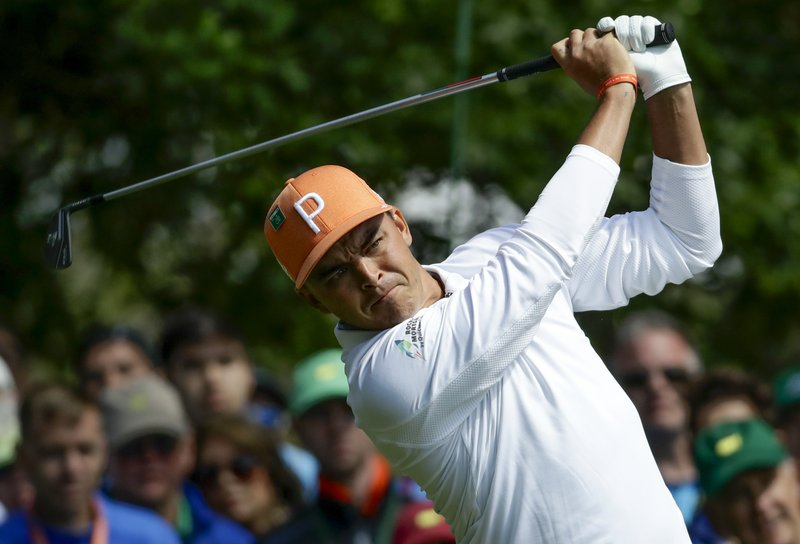Fowler, Spieth make Reed earn his 1st major championship