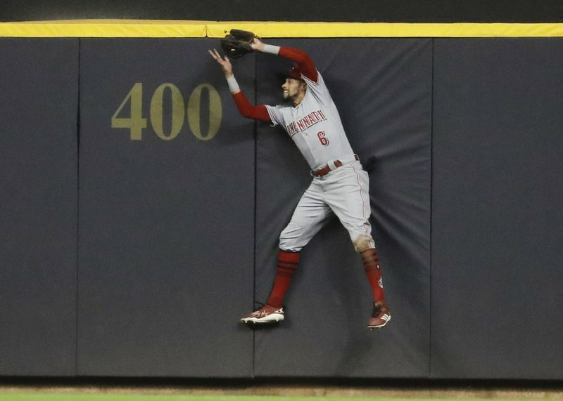 Reds cruise past Brewers 10-4 to end eight-game skid