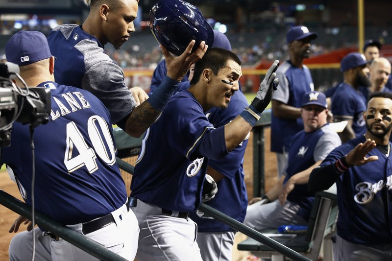On the road, Brewers go homer crazy