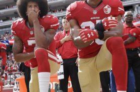 Eric Reid Colin Kaepernick kneeling AP