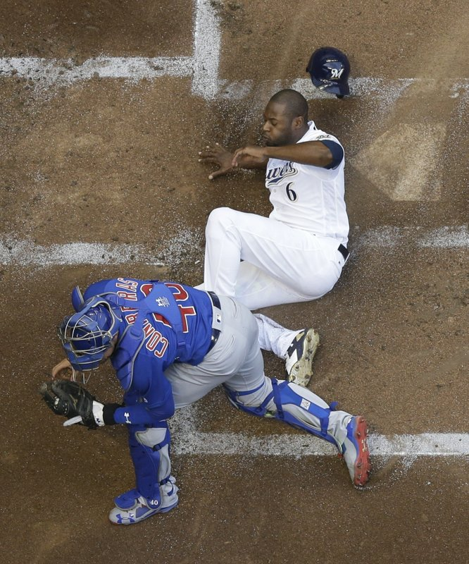 Anderson stymies Cubs as Brewers regain first place