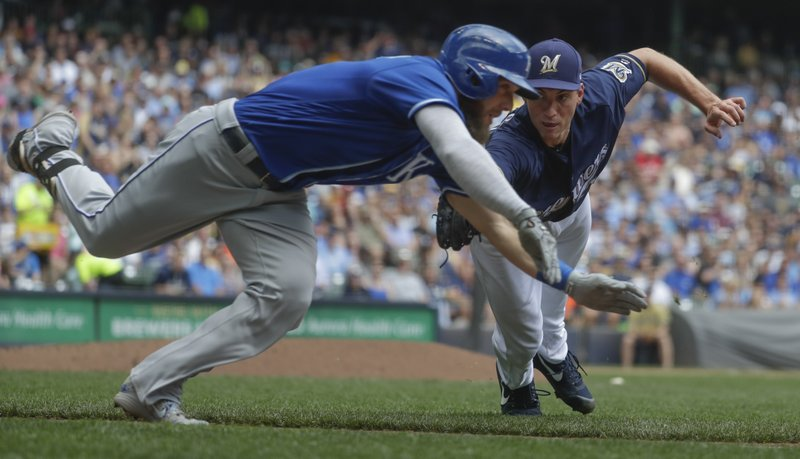 High five: Royals bust out bats to beat Brewers 5-4