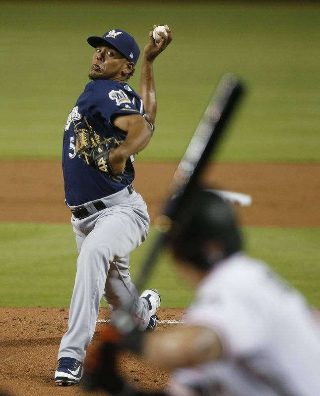 Brewers lose series with Marlins, lose both in extra innings