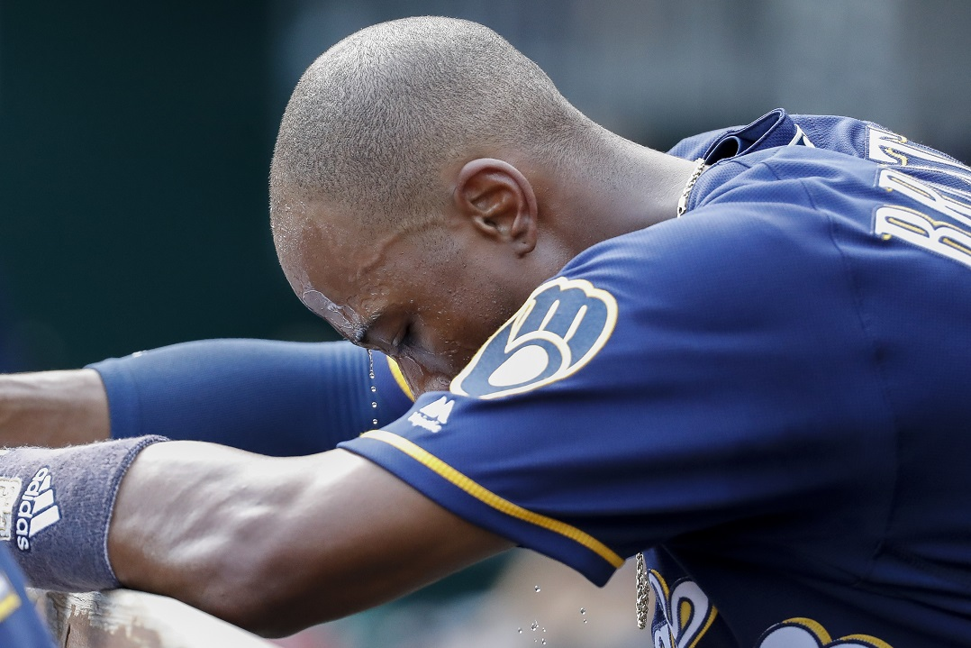 Reds hit another granny in win over Brewers