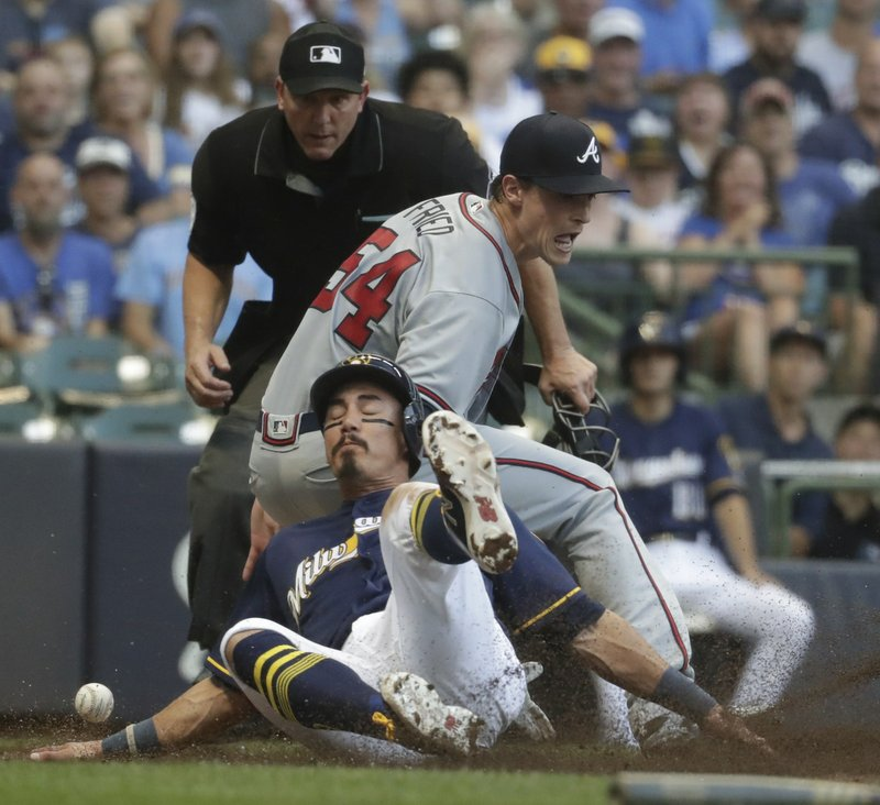 Chacin is back, as Brewers win fourth in a row in a battle of first-place teams