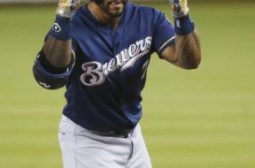 Eric Thames licking lips AP