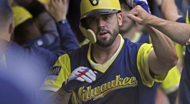 Brewers Mike Moustakas dugout AP