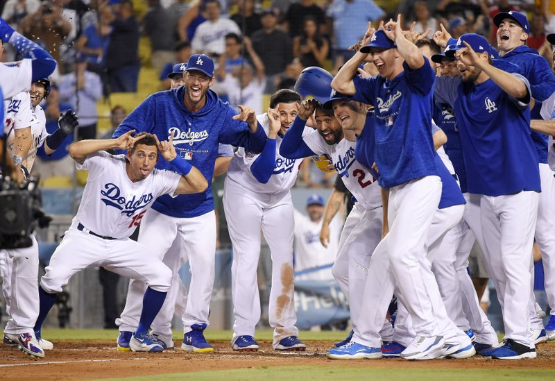 Brewers rally falls short, as Grandal's HR in 10th wins it for Dodgers