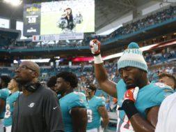Dolphins Robert Quinn fist AP