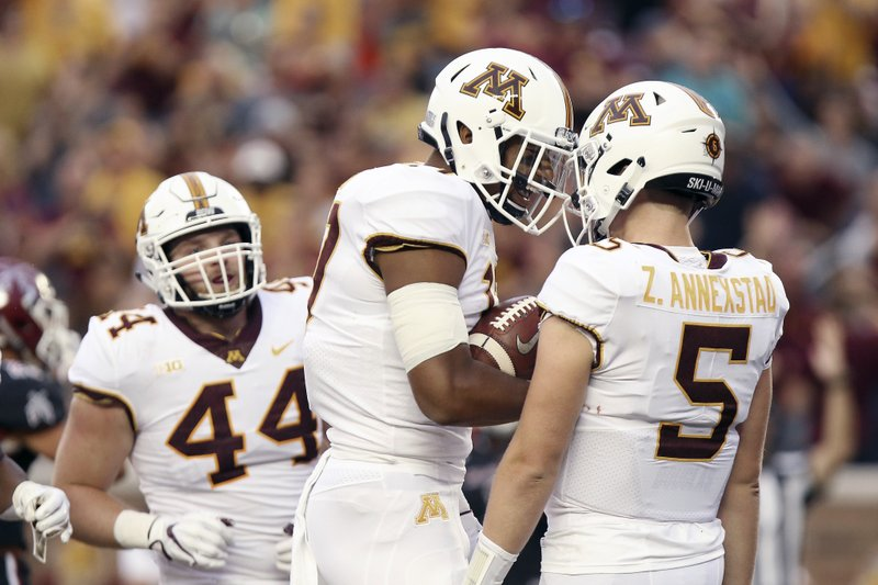 True freshman QB overcomes early stumble to lead Minnesota in blowout of New Mexico