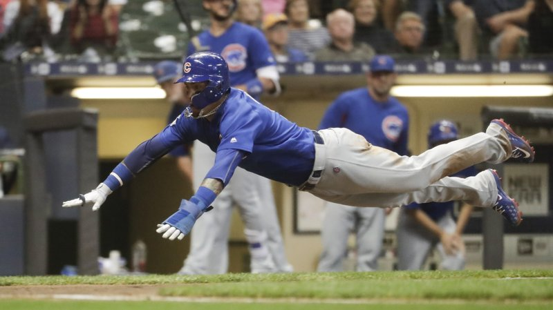 Cubs hold off Brewers, boost NL Central lead