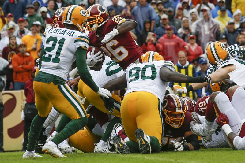 Peterson runs for 120 yards, 2 TDs, Skins top Packers 31-17