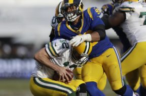 Packers Rodgers sacked Rams AP