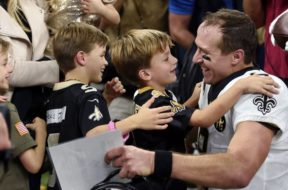 Saints Drew Brees with kids AP
