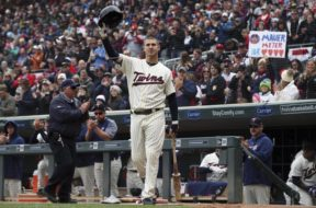 Twins Joe Mauer hat tip AP