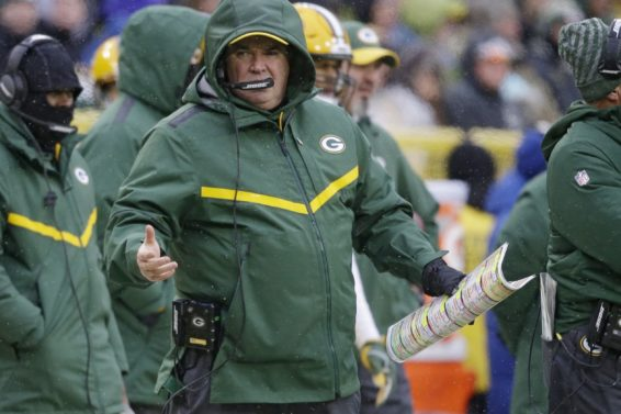 Packers Mike McCarthy raincoat AP