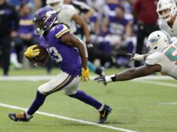 Vikings Cook v Dolphins AP