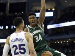 Giannis dunks Simmons face AP