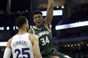 Giannis dunks Simmons face AP