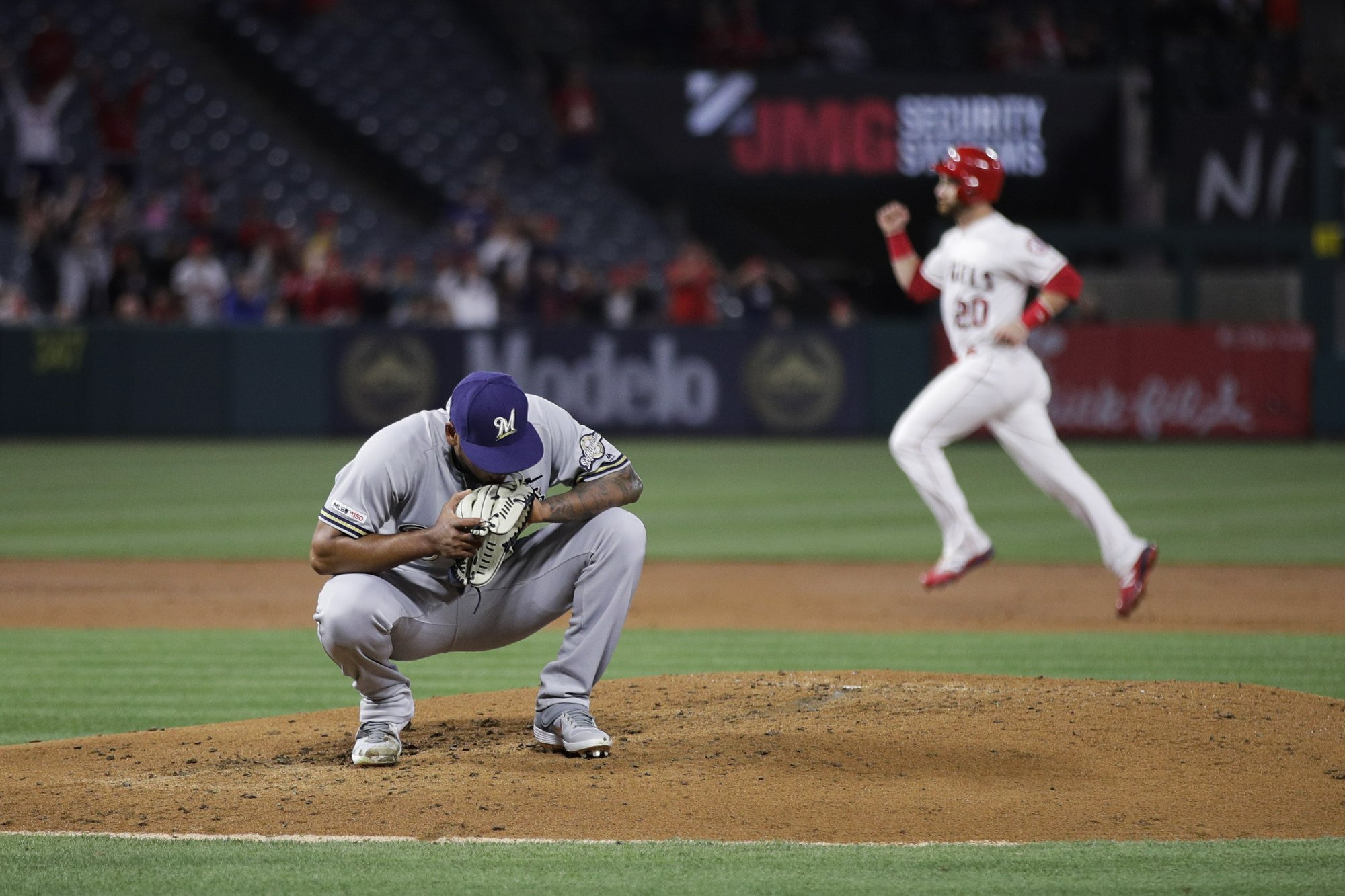 Angels rally for 11-8 win over Brewers after Trout gets hurt
