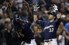 Brewers Yelich Cain celebrate HR AP