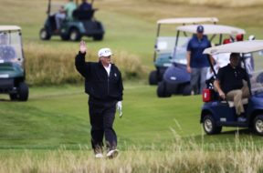 Donald Trump golfing AP