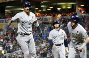Brewers Orlando Arcia celebrate Twins AP
