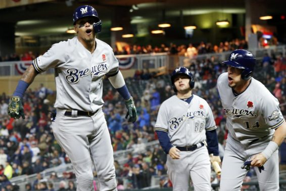 Brewers Orlando Arcia celebrate Twins AP