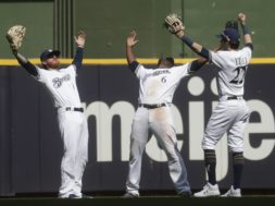 Brewers celebrate Marlins win AP