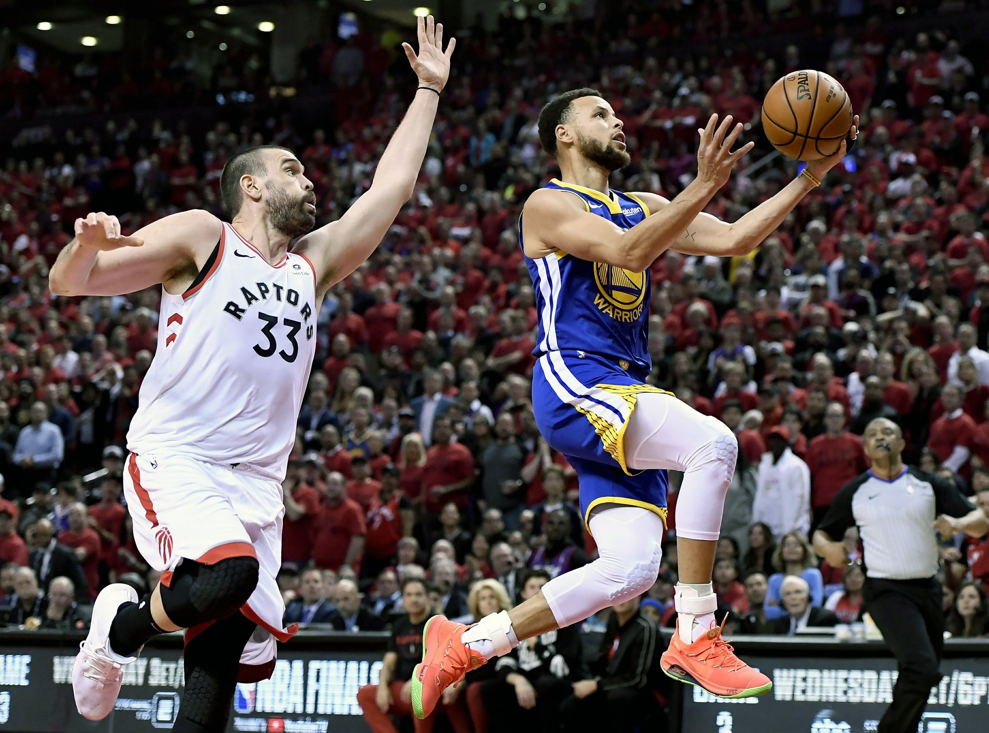 Warriors beat Raptors 109-104 to even NBA Finals