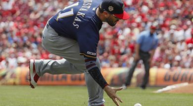 Brewers Mike Moustakas fielding AP