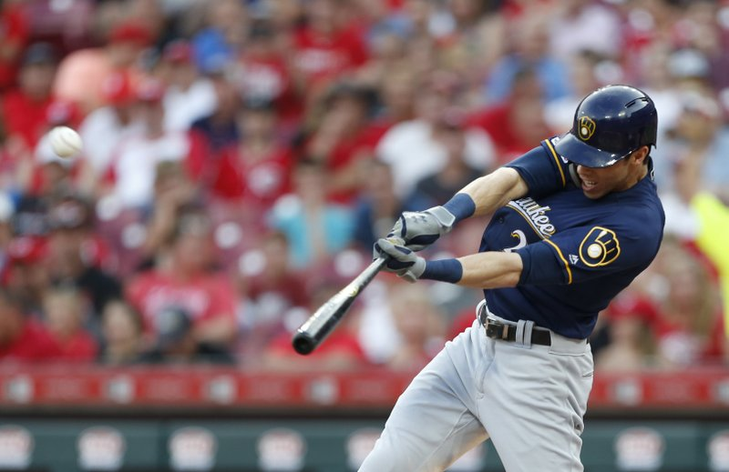 Yelich goes yard again, but Reds down Brewers in 11