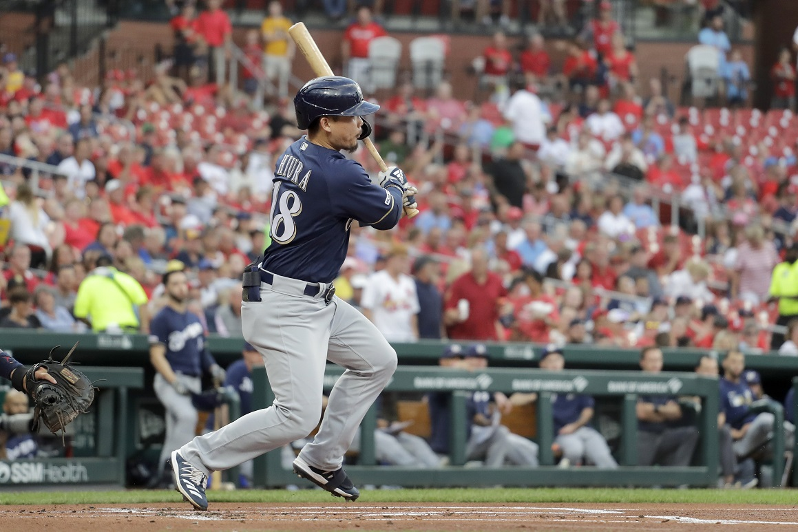 Rain helps Brewers beat Cardinals in 8