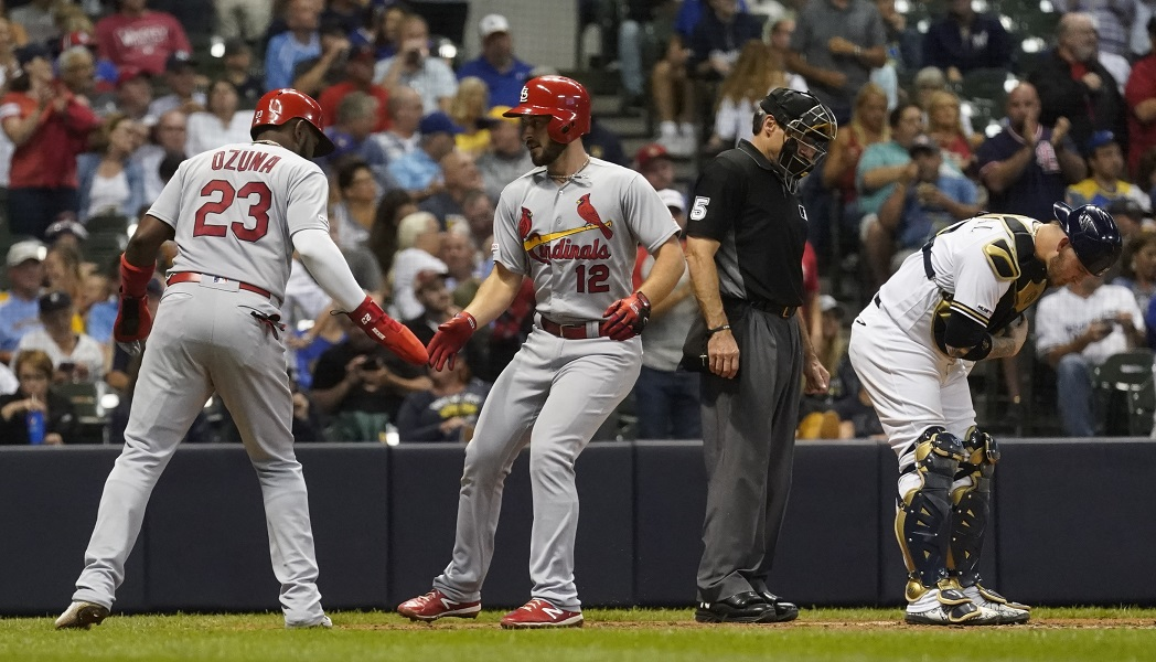 Ozuna helps power Cards past Brewers 12-2