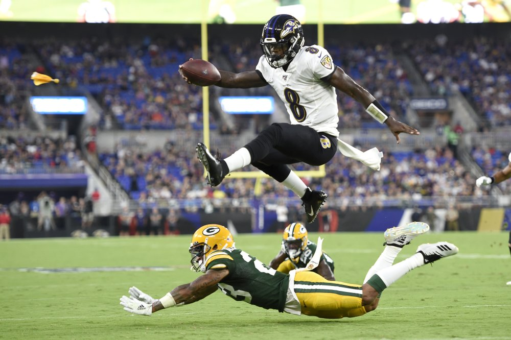 Jackson sharp, Rodgers sits as Ravens beat Packers