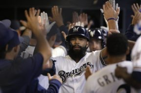 Brewers Eric Thames high five AP